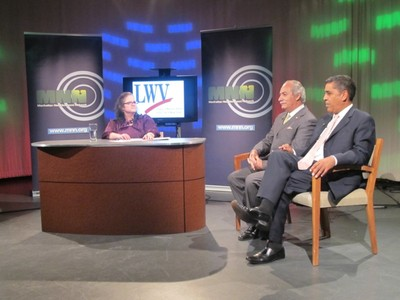Assemblyman Guillermo Linares and Sen. Adriano Espaillat on stage during a recent debate hosted by  the Manhattan Neighborhood Network.