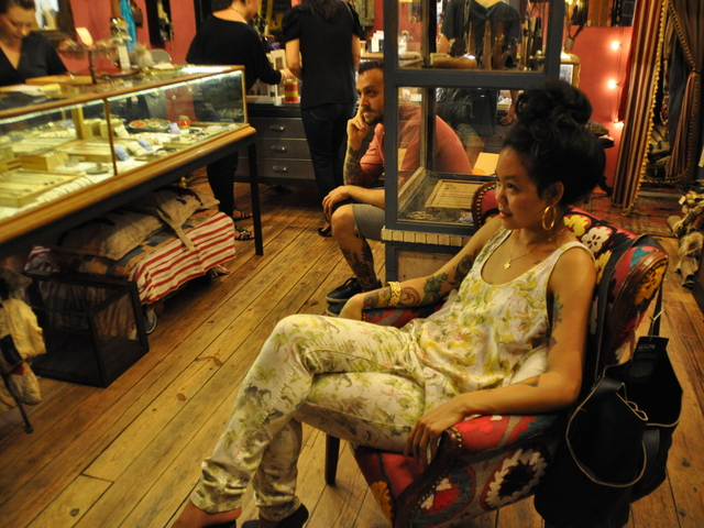 Guests listened to live music at SCOSHA boutique on Grand Street.