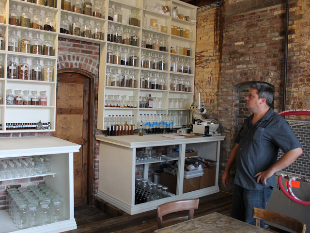 Cacao Prieto sales director Alex Clark stands in the distillery's apothecary in Red Hook.