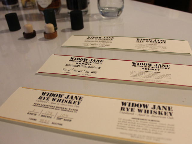 The labels for Cacao Prieto's upcoming spirits sit on a table in the distillery's offices. The Widow Jane Organic Wapsi Corn Whiskey will be aged for at least six months, sales director Alex Clark said.