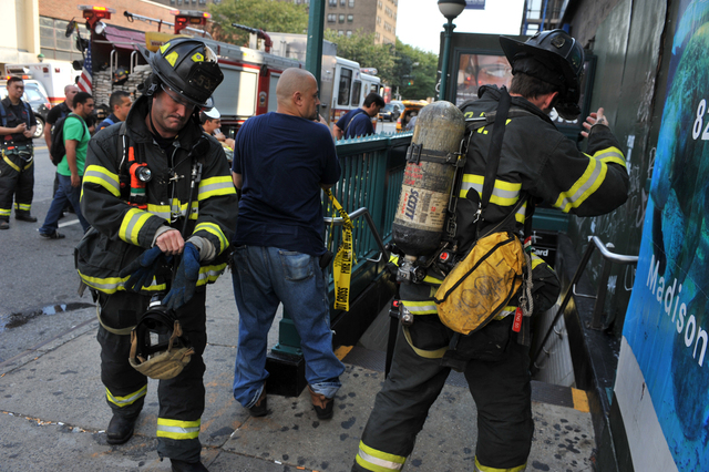 Firefighters respond to smoke conditions at the Delancey Street/Essex J and M train station, Sept. 7, 2012.