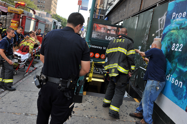 FDNY firefighters respond to a smoke condition inside the Delancey Street/Essex station, Sept. 7, 2012