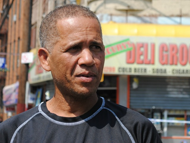 Alcibiades Cuevas stands in front of the bodega where his nephew was shot the night before on Friday September 7, 2012.