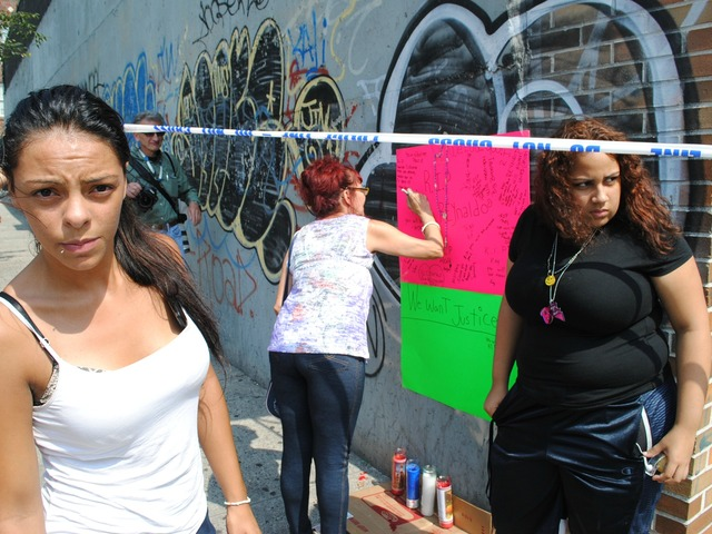 Maria Acevedo, left, was friends with Cuevas and helped create this makeshift memorial for him on Friday September 6, 2012.