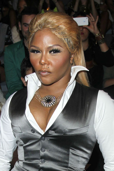 Lil Kim a little disheveled at the Mara Hoffman show at the tents at Lincoln Center, Saturday, September 8, 2012.