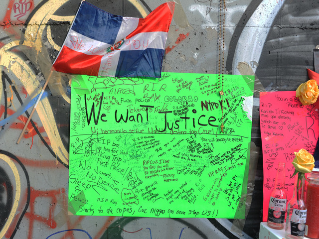 Memorial poster hangs at the site where Reynaldo Cuevas was shot on September 7, 2012, after fleeing an armed robbery