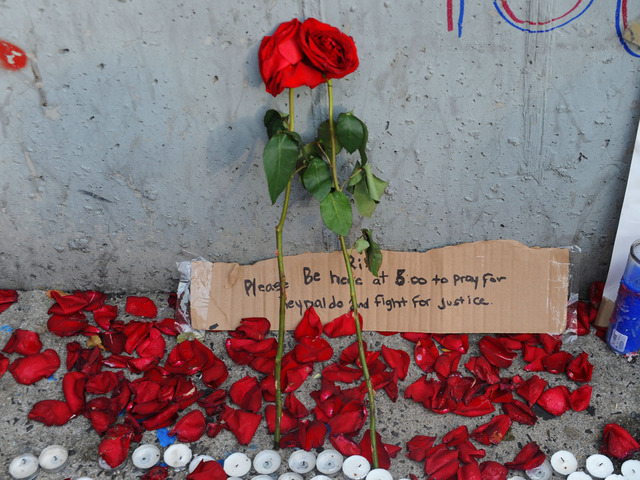 Rose and petals at the site where Reynaldo Cuevas was shot on September 7, 2012, trying to flee an armed robbery.