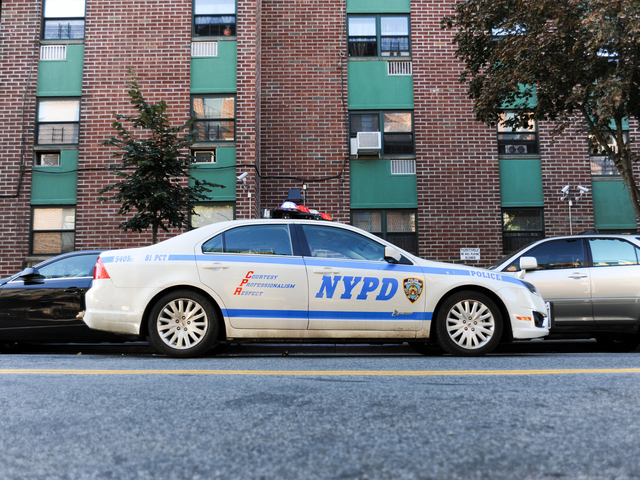 A police car sits outside of 660 Gates Avenue in Brooklyn, where a man was stabbed on Monday September 10th, 2012.