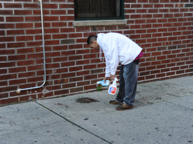A maintenance worker prepares to wash away the victims' blood on Monday September 10th, 2012.