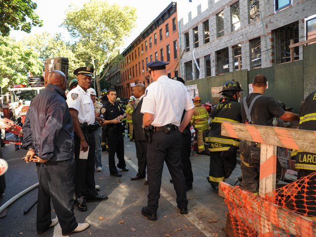 Officials at 227 Carlton Avenue in Brooklyn, where a building collapsed on September 10, 2012.