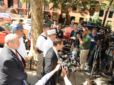 FDNY Deputy Assistant Chief James Leonard and Commissioner Robert LiMandri from the Department of Buildings address the media at the scene of a fatal building collapse on Monday September 10th, 2012.