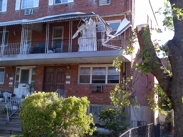 Winds shredded a balcony awning at 1621 Canarsie St. on Saturday September 8, 2012.