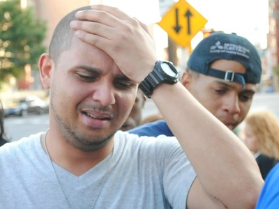 Joel Cuevas, 26, arrives at the scene where his brother Reynaldo, 20, was shot by a police officer while fleeing a bodega robbery on September 7, 2012.