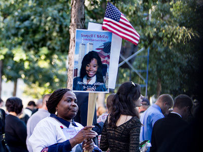 Family members of 9/11 victims brought photos of their loved ones to the ceremony in Lower Manhattan Sept. 11, 2012.