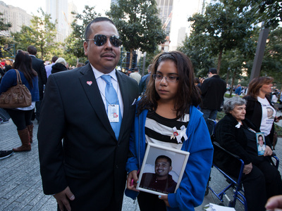 Hailey Perez, 12, from Clifton, N.J., with her uncle at the 9/11 Memorial Sept. 11, 2012,  mourned her godfather Kenny Lira, who was killed in the South Tower.