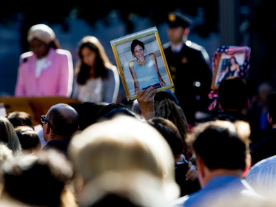 Family members of 9/11 victims held photos of their fallen relatives at the World Trade Center Sept. 11, 2012.