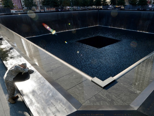 Scott Willens, who joined the U.S. Army three days after 9/11, at the Ground Zero memorial Sept. 11, 2012.