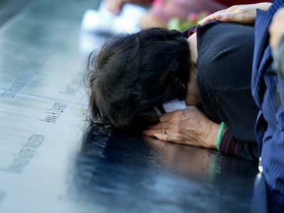A woman cries at the 9/11 Memorial on the 11th anniversary of the attacks Sept. 11, 2012.