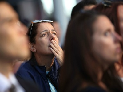People in Lower Manhattan looked up at the World Trade Center on the 11th anniversary of the attacks Sept. 11, 2012.