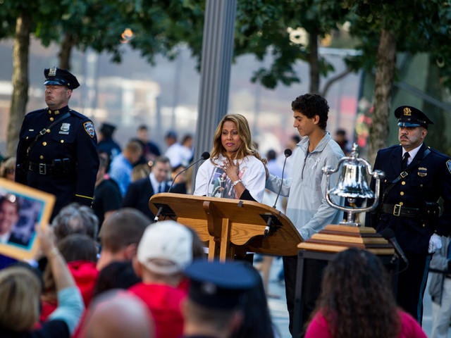 Relatives of 9/11 victims read names of the fallen at a ceremony for the 11th anniversary of the attacks Sept. 11, 2012.