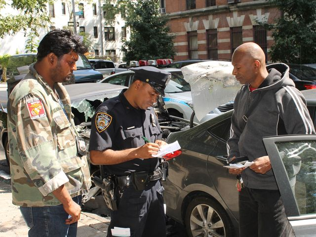 Hyundai owner Ayodele Maakheru (r) talks to police.