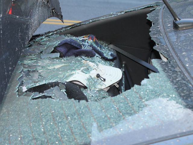 The smashed windscreen of the Mustang.