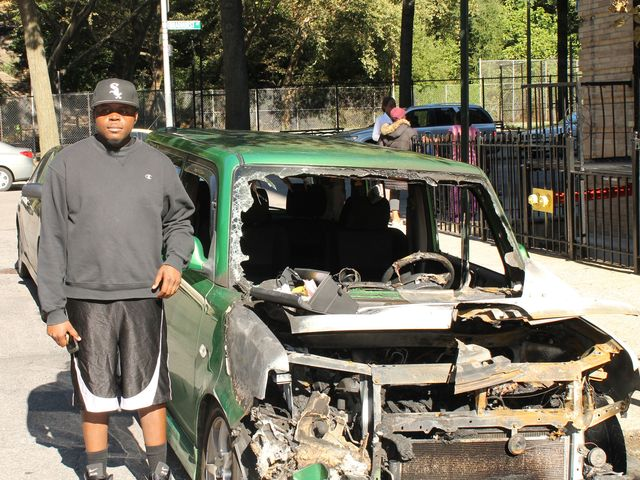 Jamel Watson stands by his destroyed Scion.