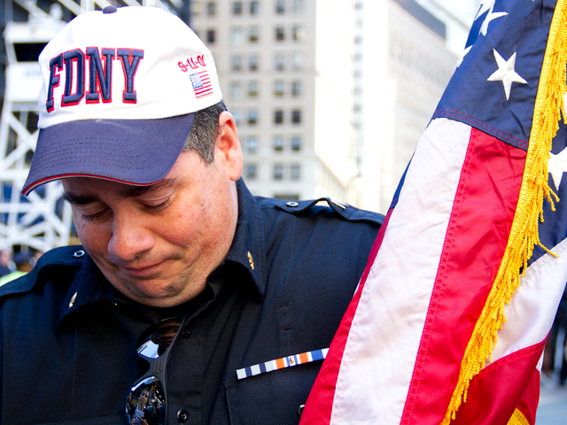 <p>Ken Corrigan, 45, a volunteer fire fighter and first responder on Sept. 11, 2001, visits Ground Zero on the 11th anniversary of 9/11.</p>