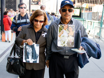 A mother and father who lost their daughter Sept. 11, 2001 exit the reading of the names ceremony at Ground Zero Sept. 11, 2012.