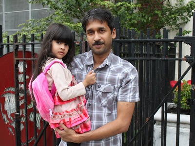 Mustakin Khondkir with his daughter Anamta, 4, who started Pre-K at P.S. 70.