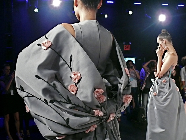 Cennamo's gray gown with cherry blossom embroidery and oversize bow sleeves.