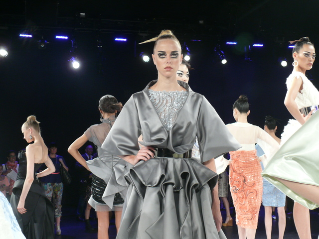 Cennamo's gray origami cocktail dress with gunmetal belt.