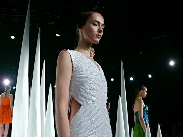 Mirano's white sequined mesh column gown.