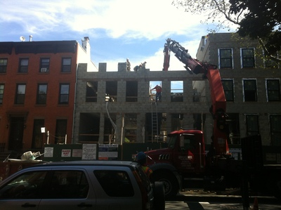Workers cleared debris at the site of the building collapse on 227 Carlton Avenue.