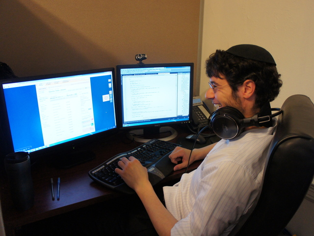 A programmer at Chabad.org in Crown Heights writes code for the upcoming relaunch. The site, which sees 1.7 million unique visitors each month and many times that during major holidays, was built in-house by a small but dedicated team.