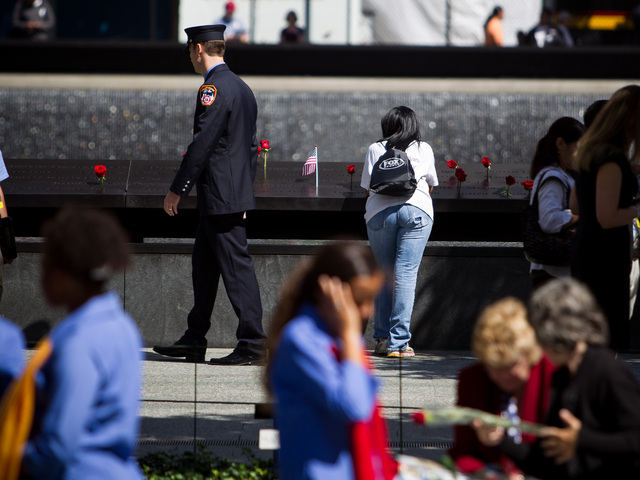 Relatives of 9/11 victims pay their respects at the memorial Downtown Sept. 11, 2012.