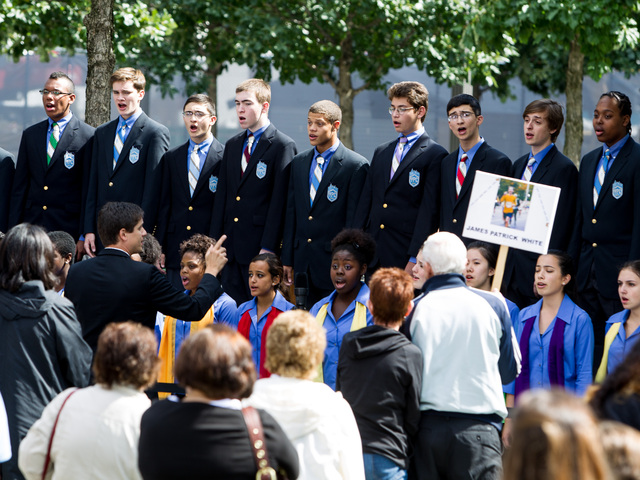 A choir sings at the closing of the 11th Anniversary Ceremony Downtown Sept. 11, 2012.
