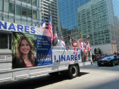Advertisements for Mayra Linares and her father appeared on the same truck at the Dominican Parade.