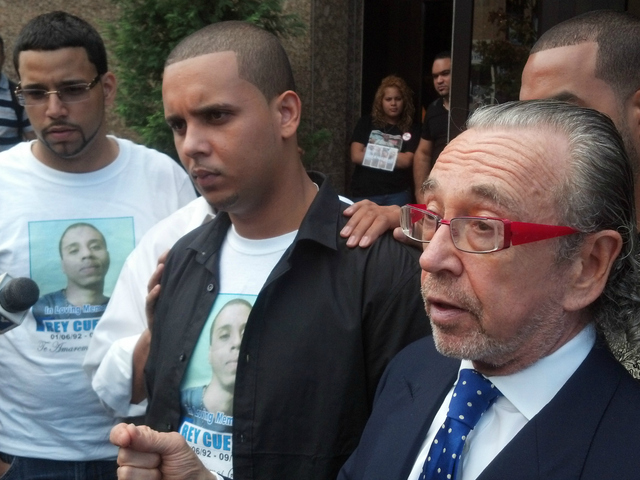 Joel Cuevas (center), Reynaldo's brother, stands next to Sanford Rubenstein (right), the family's attorney.