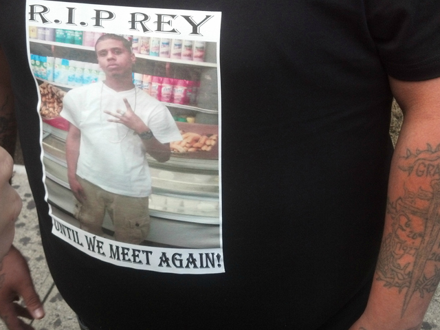Many mourners wore t-shirts with photos of Reynaldo Cuevas to his memorial service.