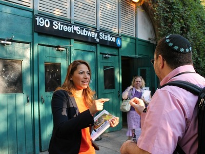 Assembly candidate Mayra Linares campaigns at the 190th Street station Wednesday morning.