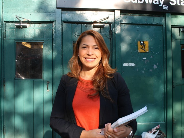 Assembly candidate Mayra Linares campaigns outside of the 190th Street subway station Wednesday morning, ahead of Thursday's primary.