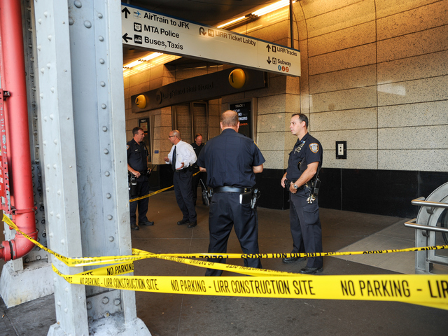 Police Officers at the Jamaica Station where three people were stabbed on Wednesday September 12th, 2012.