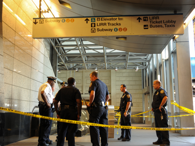 Police Officers close off subway access at the scene where three people were stabbed on Wednesday September 12th, 2012.