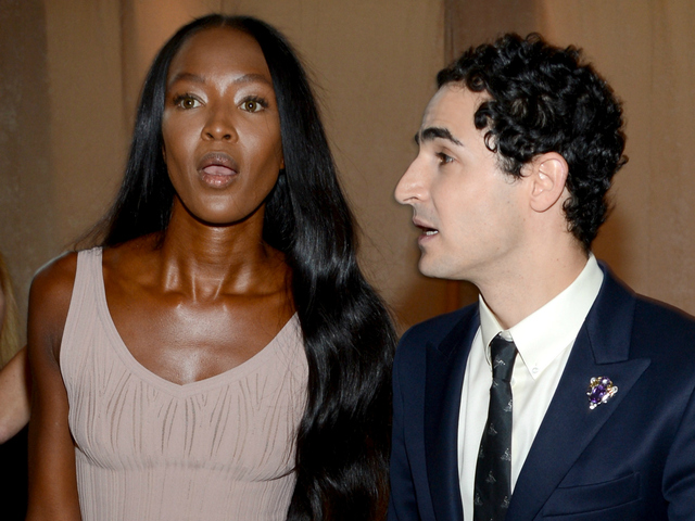 Naomi Campbell and designer Zac Posen prepare backstage at the Zac Posen Spring 2013 fashion show during Mercedes-Benz Fashion Week at Avery Fisher Hall at Lincoln Center on Sept. 9, 2012. An argument between three French fashionistas and PR executive Lynn Tesoro broke out at the show over seating.