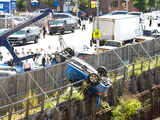 Out-of-Control Car Plunges 40 Feet Into Construction Site in Brooklyn