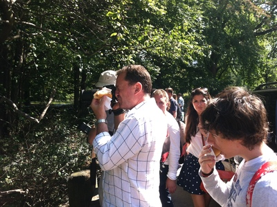 Tourists took pictures of the crime scene in Strawberry Fields Sept. 12, 2012.