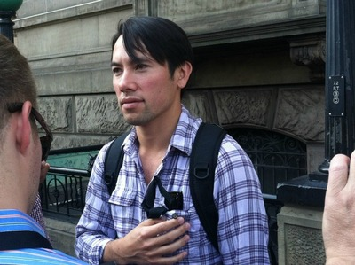 Eric Ozawa, an NYU professor, called 911 after finding a 74-year-old woman who had been raped in Central Park.