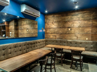 The owners of The Stand used 200-year-old reclaimed wood to help in the soundproofing of the lower level comedy club and to add warmth to the space.