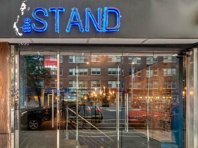 The owners of The Stand worked closely with Mike DeStefano, a comedian who died in 2011, and chose to pay tribute to him by including a black-and-white rendering of the late comic as part of their logo and signage.